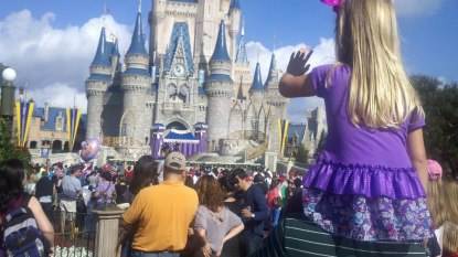 Madisyn on Paw Paws shoulders watching the show at the Enchanted Castle!