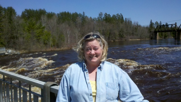Rosalyn enjoying the rushing Big Fork River!