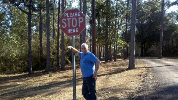 roy by stop sign
