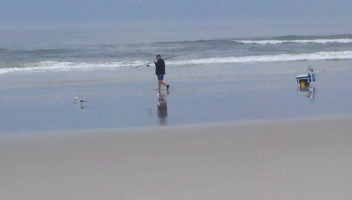 sa beach man fishing with chair