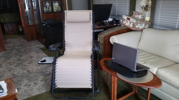 tan lounger with table