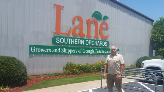 roy in front of lane southern orchards